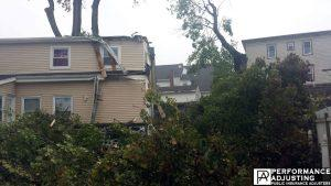 tree fell on a house from a storm in Providence, Rhode Island