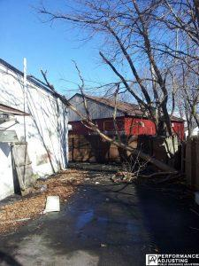 tree on house damage from a storm in Cranston, Rhode Island
