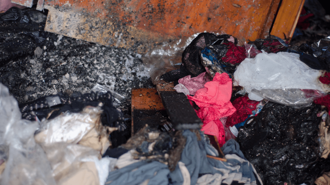 What Should You Throw Away After a Fire? Burned clothes and fabric due to fire damage