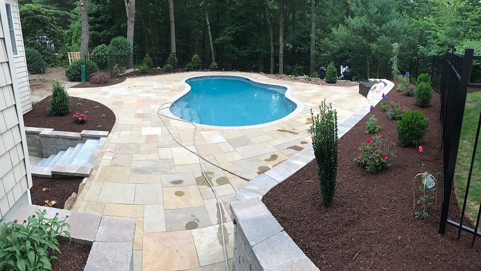 Patio, pool, and retaining walls