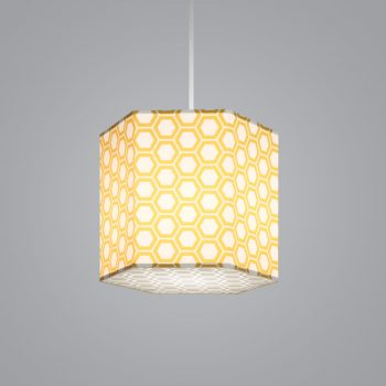 Lumetta's custom Hexagon Lite Pendant is shown with a yellow honeycomb Lumenate® diffuser and a etched honeycomb white acrylic bottom lens.